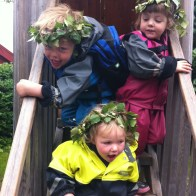 Leon, Frida and Lottie wearing their midsummer laurel crowns at Skansen in Stockholm.