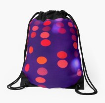 Indigo and Orange Blurred Lights - drawstring bag