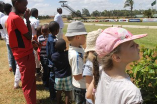 Lottie, Leon and Frida eagerly waiting by the finish line at Heading down the home straight at Ngong Racecourse in Nairobi