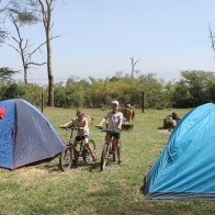 Our tents and Lottie and Leon on their hired bikes