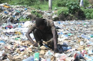 People going through the rubbish tip on the streets of Mombasa, Kenya
