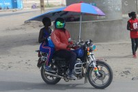Piki Piki with an umbrella in Nairobi
