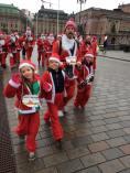 Lottie, Leon , Mark and Frida running past the Swedish Parliament in the 2018 Stockholm Santa Run