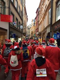 The 2018 Stockholm Santa Fun Run passing through Gamla Stan