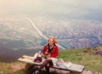 Ali on top of a mountain above Innsbruck in Austria