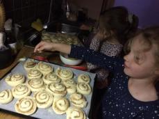 Lottie and Frida making Kanelbullar
