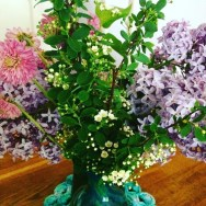 Lilac and other flowers from the garden on the table