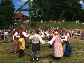Dancing round the midsummer maypole at Bruket Görvälns in Järfälla, Stockholm