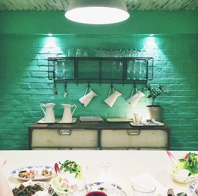 Lovely turquoise walls and vintage decor