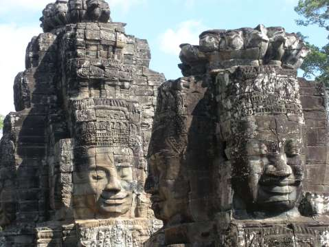 Two huge statues of face statues in Angkor Wat