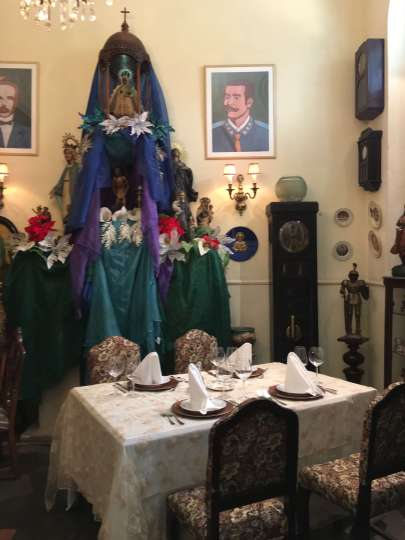 Santeria altar, San Cristobal paladar, restaurant, Havana, Cuba.