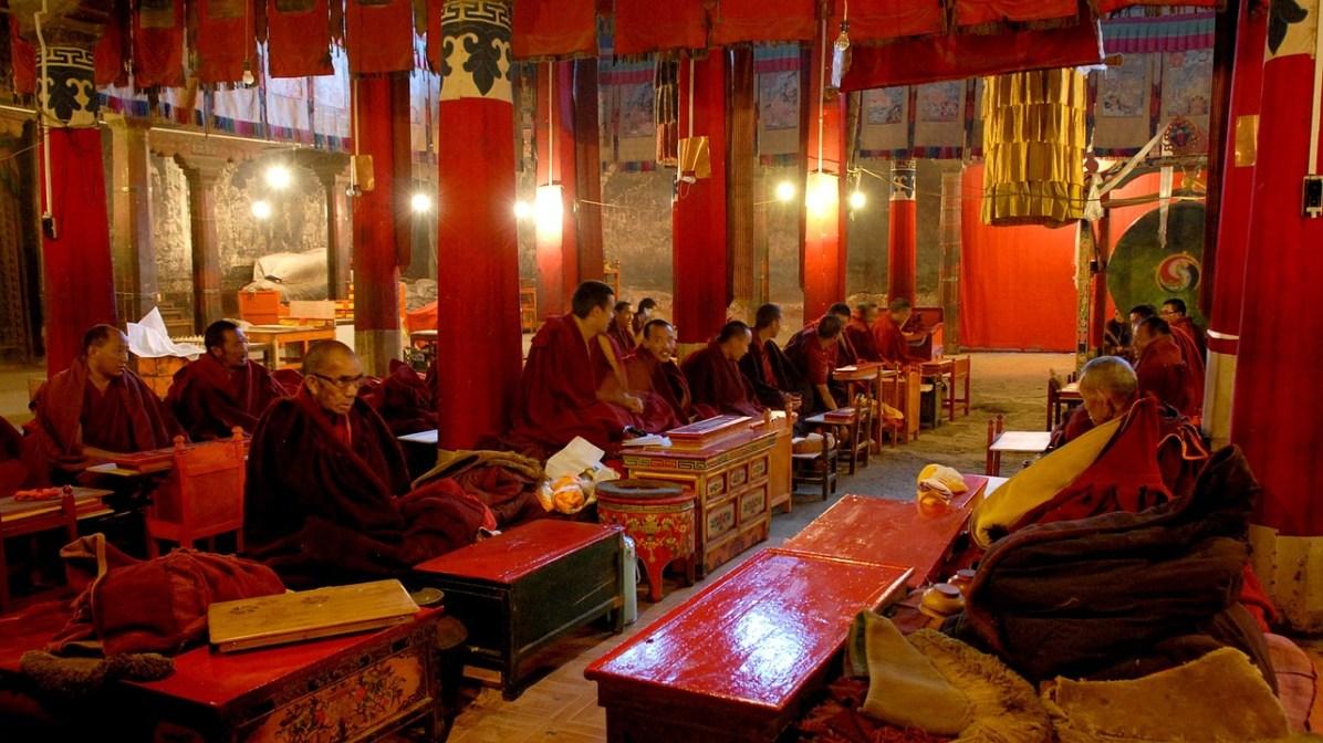 Tibetan monks at prayer in Potala Palace in Lhasa, Tibet