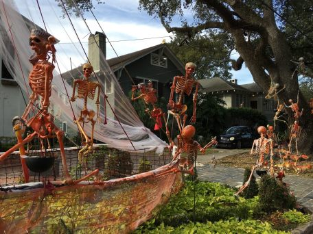 Skeletons frolic on a New Orleans lawn