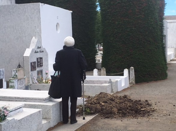 grieving woman at open grave