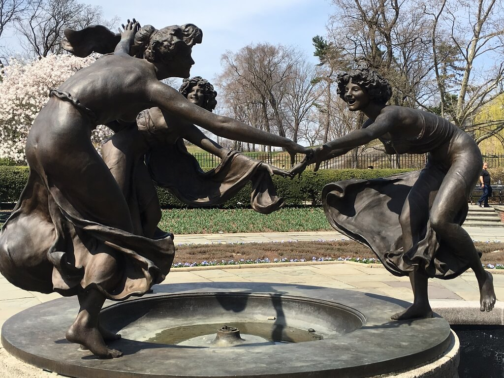 statue of three women dancing at the Conservatory garden, one of the most underrated attractions in NYC