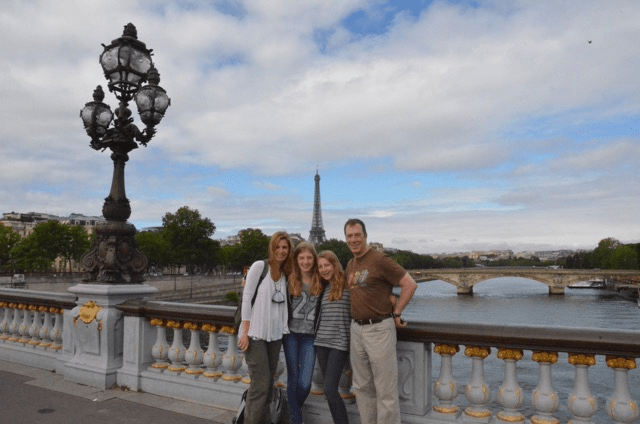 With her family in Paris.
