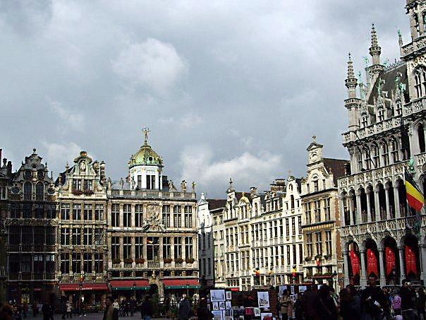 Grand Place with Belgian Flag. Brussels, Belgium.