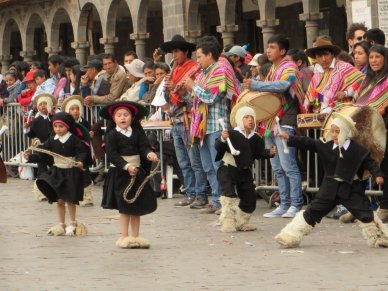 Children dancing in Cusco festival, Peru