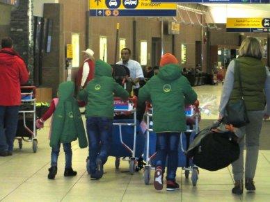 image refugee children Calgary airport