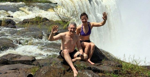 Couple sitting near Angel's Pool Victoria Falls