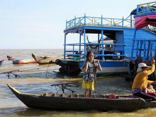 Tonle Sap lake Cambodia child with snake