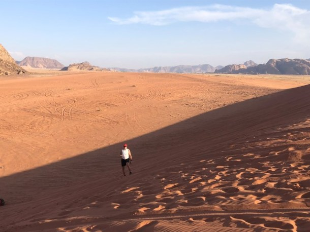 A view across the Wadi Rum desert from the top of a sand dune