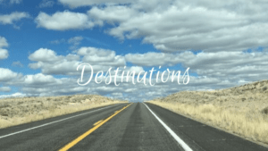 Destinations Button Blue Skies and Open Road