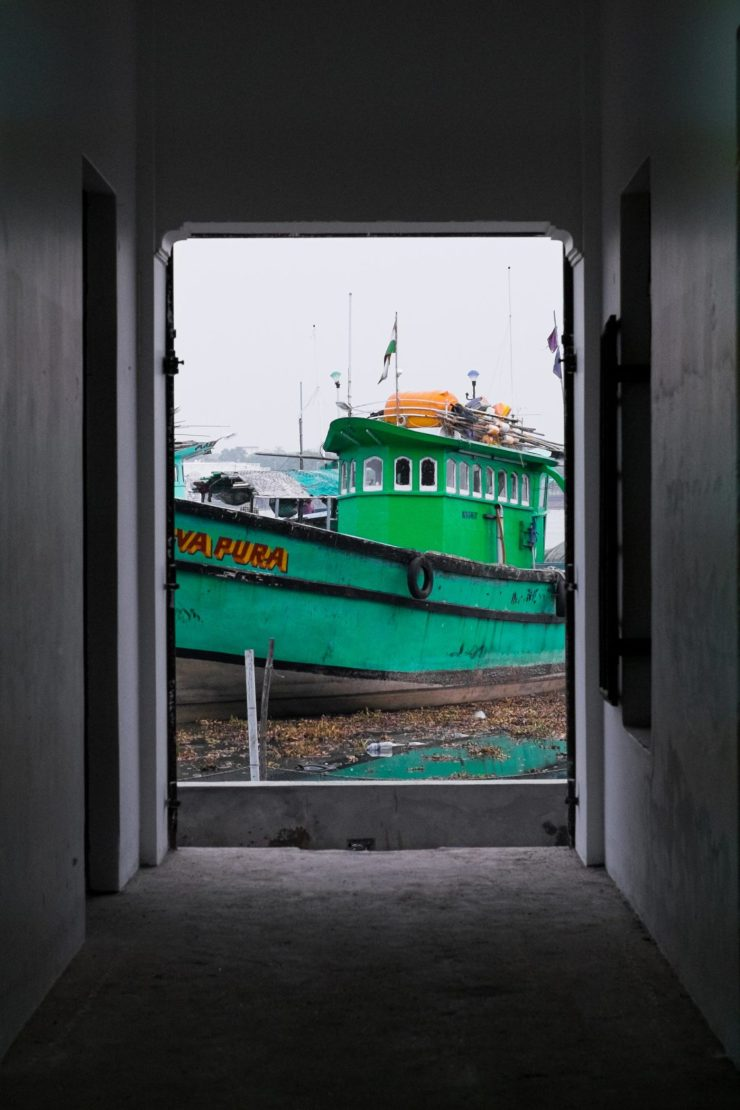 Boat through a doorway in Fort Kochi
