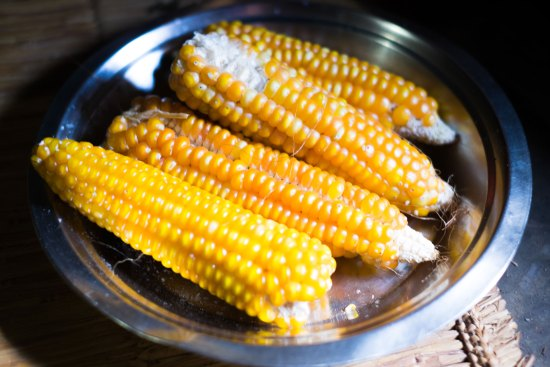 Dried corn cobs in a silver dish