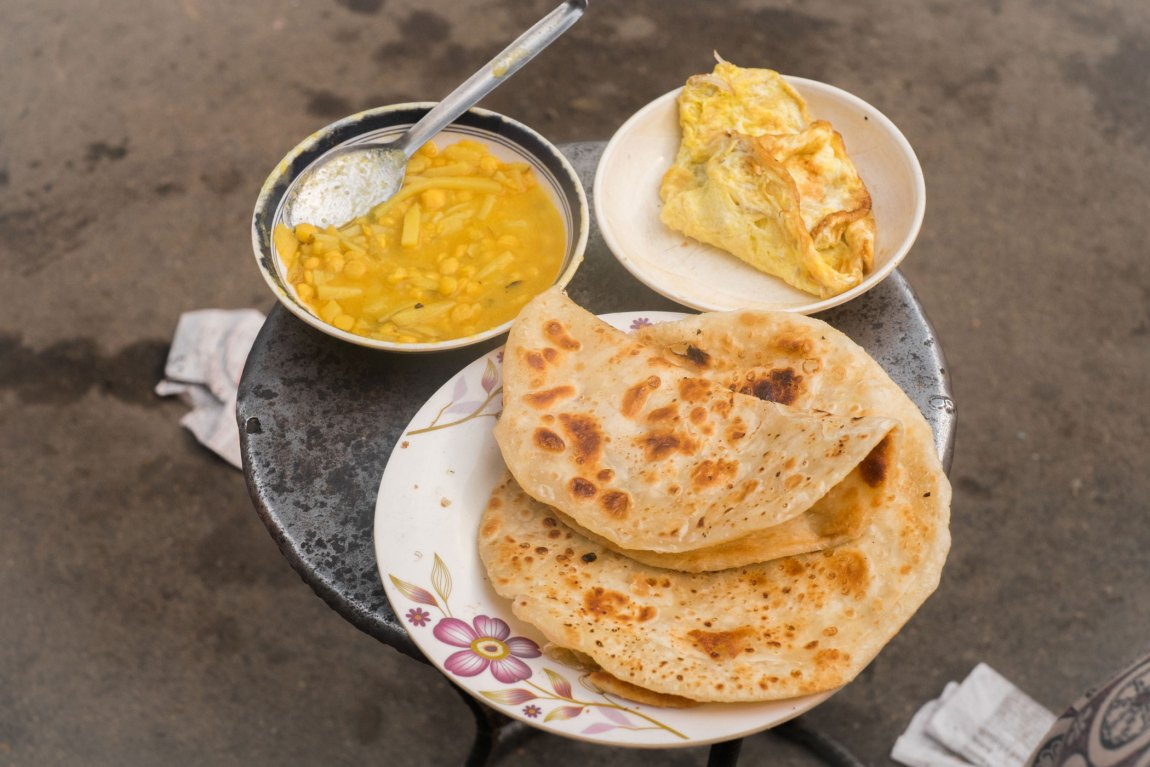 Paratha, dal and omelette on a table in Barisal, Bangladesh. A typical breakfast in this part of the world.