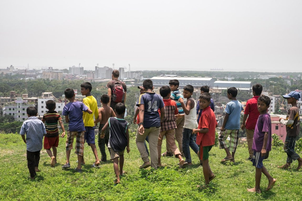 Children follow a tourist in Chittagong.