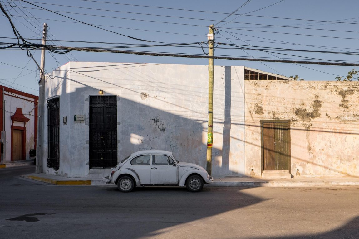 A white beetle car on a street in Mexico.