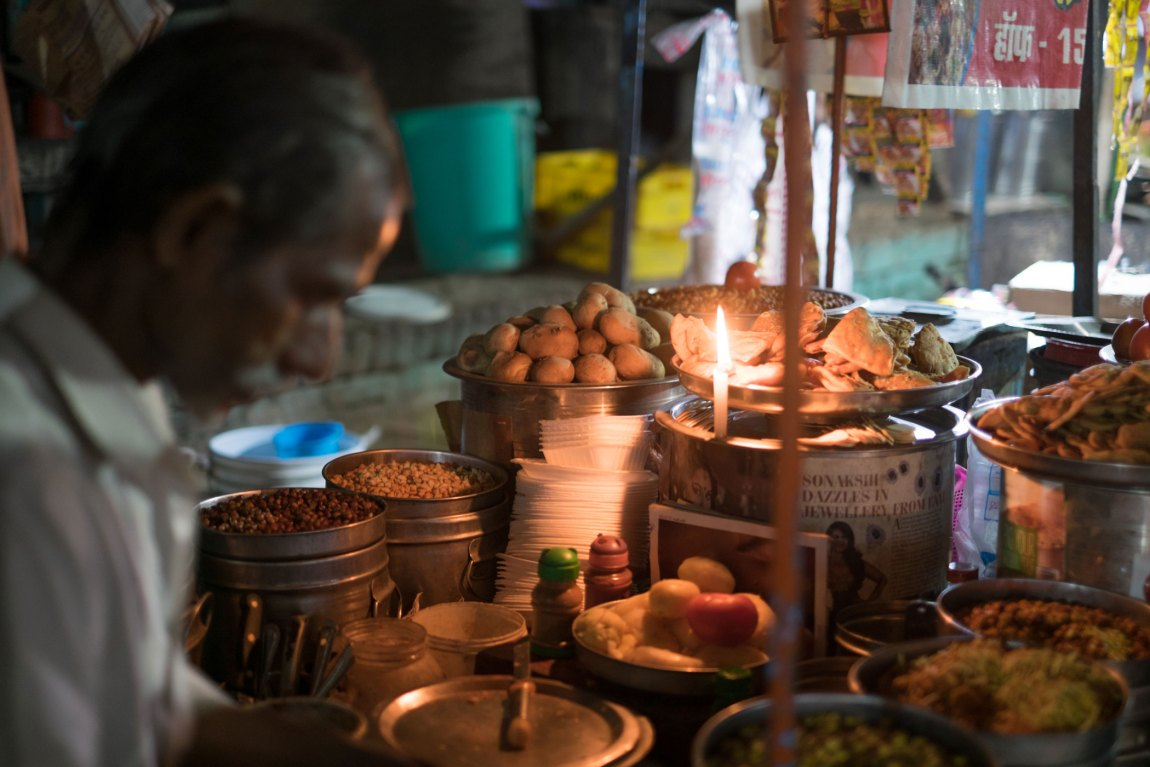 A food vendor at his stall in Varanasi.