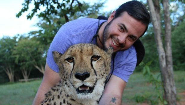 Ben hugging a cheetah
