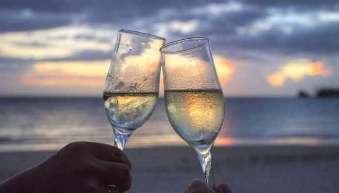Celebrating your honeymoon with champagne