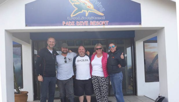 group of people in front of dive shop