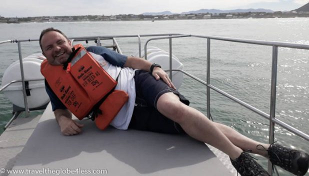 Man laying on a boat