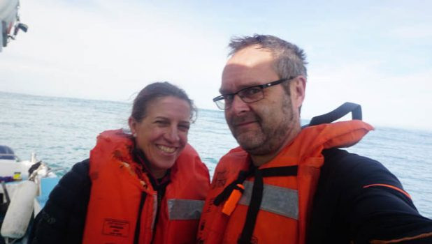 Anne & Jason in life jackets awaiting rescue