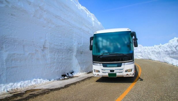 bus on snowy road in Japan
