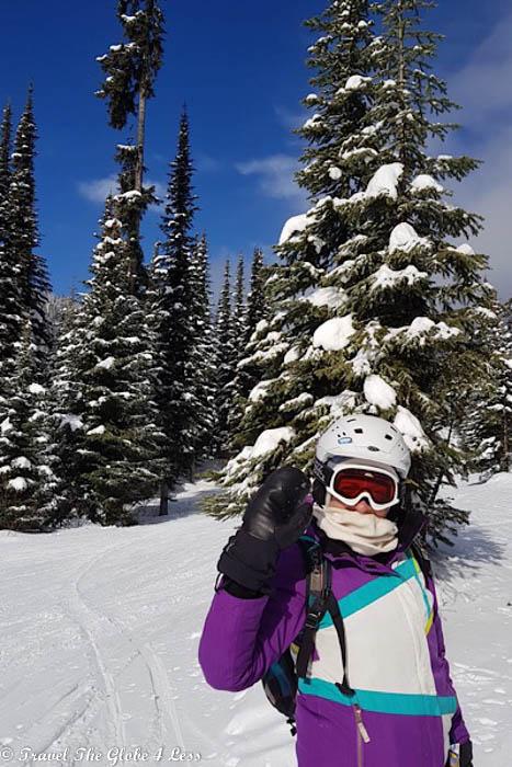 Anne on the ski slope waving