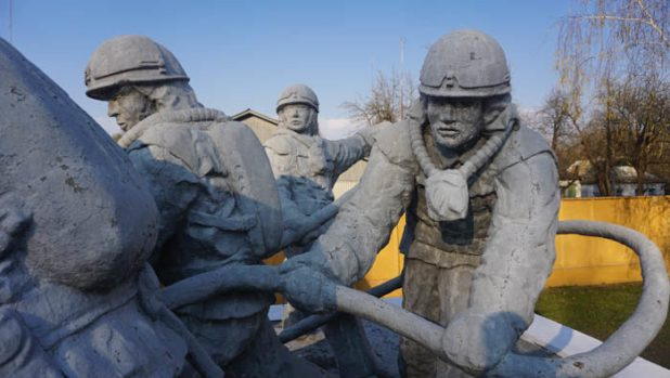 Firefighters at the Chernoby monument