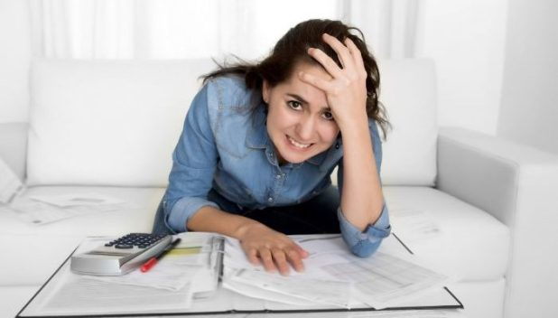 frustrated lady looking at finances