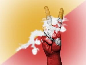 bandiera bhutan e simbolo vittoria
