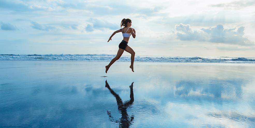 young woman skipping on water