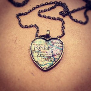 Heart shaped necklace with a map of Portland Oregon