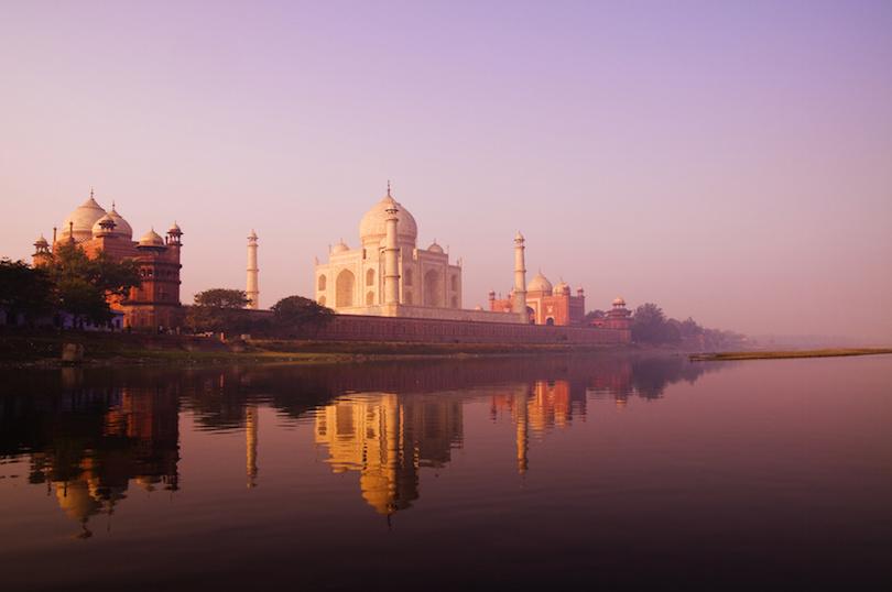 Beautiful Scenery Of Taj Mahal And A Body Of Water