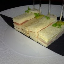Sandwiches with cheese, salmon and ham