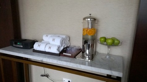 Water, apples and towels in the gym