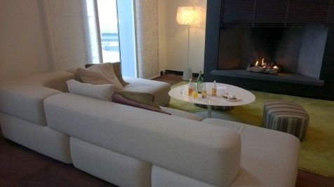 Sofa and fire place in the Executive Lounge