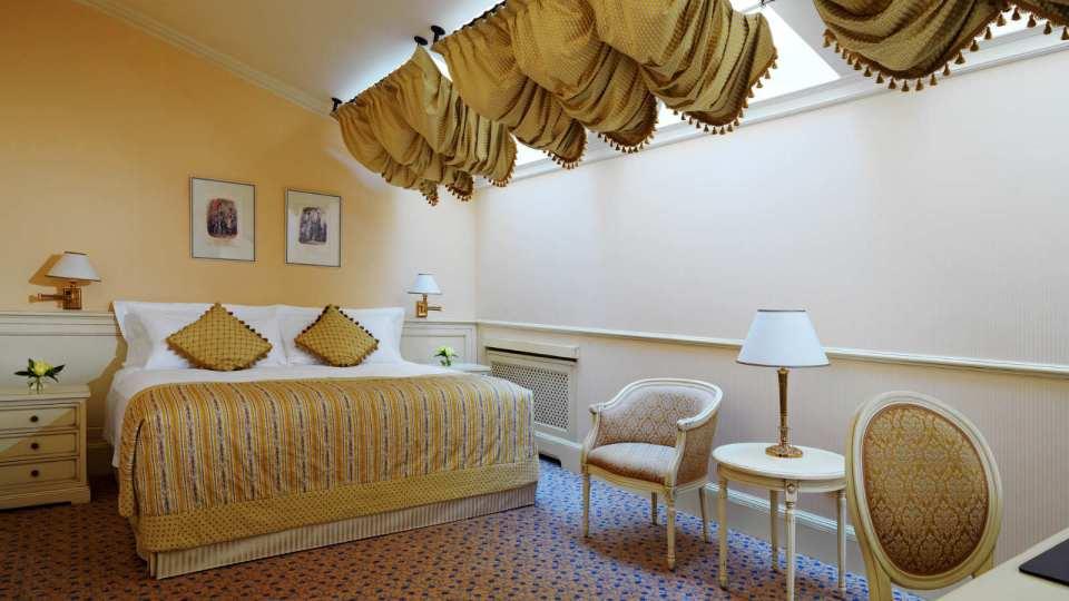 The lowest room category: Mansarde Room (Image Source: Hotel Bristol Odessa / hotelbristolodessa.com)